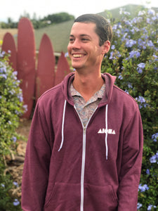 Young man wearing a fleece zip-up hoodie with Aloha Shapes ® logo