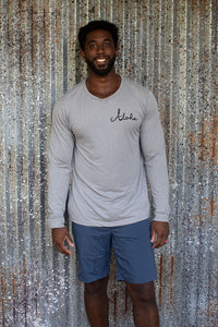 Man wearing Light grey long sleeve unisex tee printed on front left chest with Aloha written in cursive