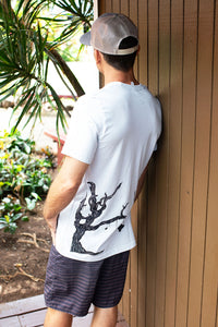Man wearing silver Giving Tree design t-shirt showing back of shirt with tree hanging Hawaiian island chain