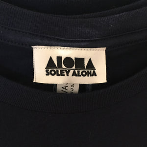 Closeup picture of custom woven Soley Aloha labels inside collar of shirt