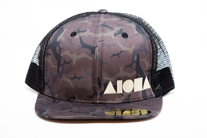 Adult flat brim snapback with Black & Brown repeating iwa bird pattern
