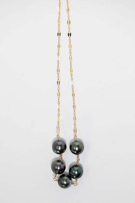 Necklace 14 karat gold fill with five Tahitian pearls strung between spacers. handmade in Maui, Hawaii
