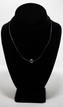 Tahitian pearl strung on black leather necklace handmade in Maui, Hawaii