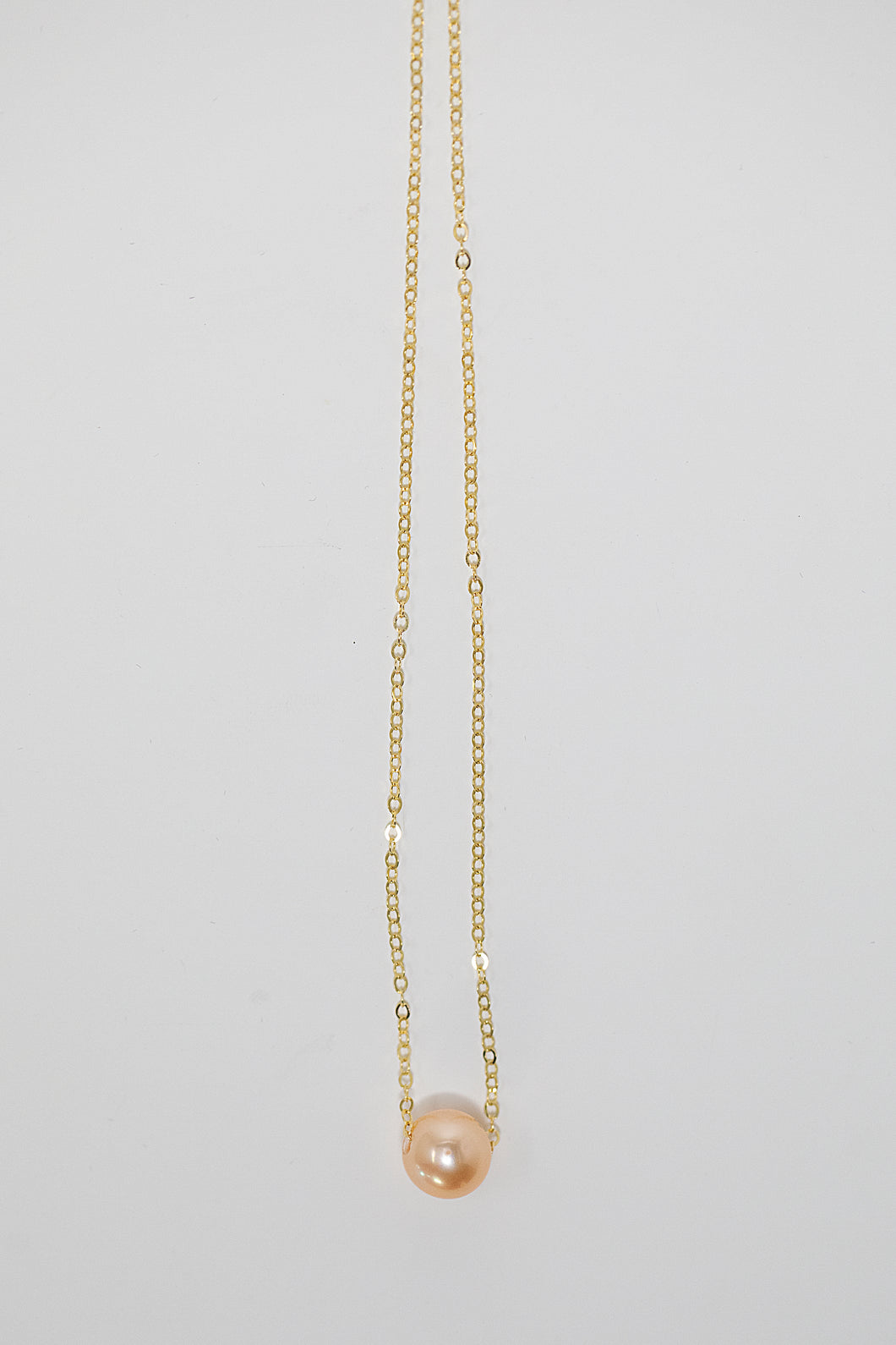 Single pink Edison pearl floating on gold fill chain handmade in Maui, Hawaii