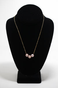 Three floating pink Edison pearls on gold fill chain handmade in Maui, hawaii