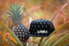 """Maui Golden"" snapback hat in a pineapple field in Maui, Hawaii."