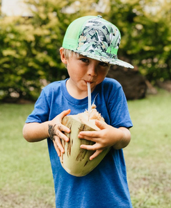 "Young blond hair boy drinking a coconut wearing the ""Nanner"" keiki snapback hat"