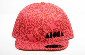 "Adult flat brim printed with Pink & Coral splatter pattern with hidden shakas, Maui and ""Nō Ka ʻOi"""