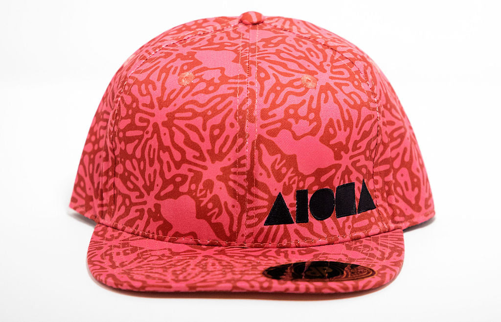Adult flat brim printed with Pink & Coral splatter pattern with hidden shakas, Maui and