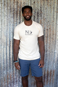 Tall man smiling wearing a No Worries unisex t-shirt
