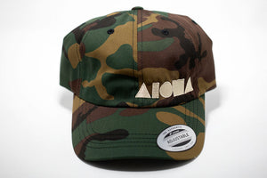 Camo print fabric adult curved bill baseball cap embroidered with cream color Aloha Shapes ® logo