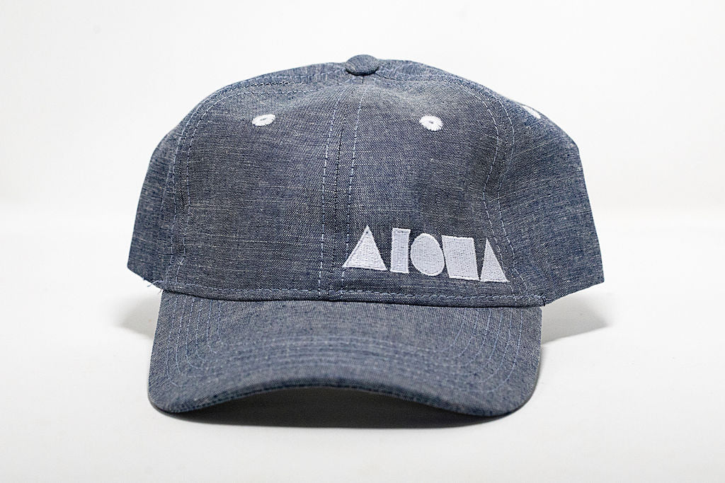Blue denim dad hat embroidered with white Aloha Shapes® logo
