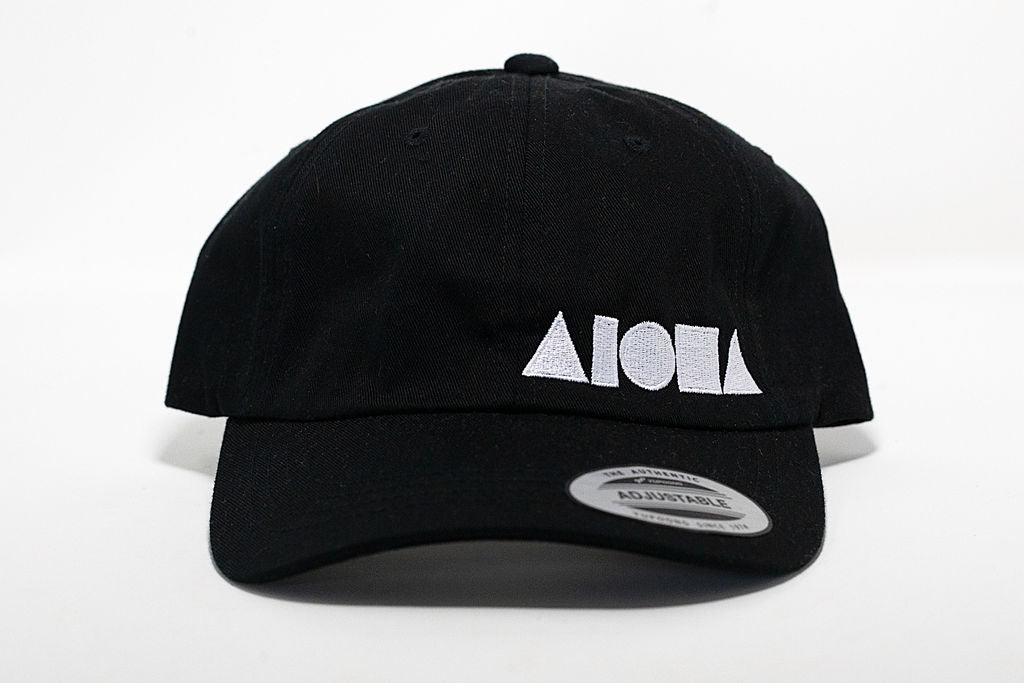 Black curved brim baseball cap/dad hat embroidered with white Aloha Shapes® logo