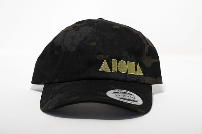 Black/grey camo print dad hat embroidered with gold Aloha Shapes® logo