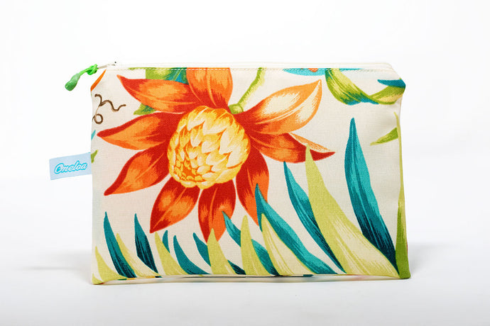 Handmade clutch size wet/dry bag made in Maui, Hawaii with floral pattern