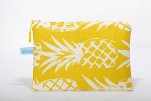 Clutch size wet/dry bag handmade in Maui, Hawaii with yellow and white pineapple pattern