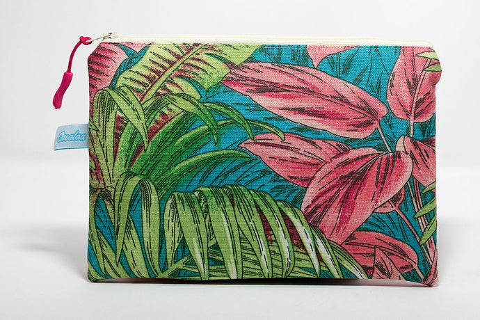 clutch size wet/dry bag in a pink/green tropical plant pattern. handmade in Maui, Hawaii
