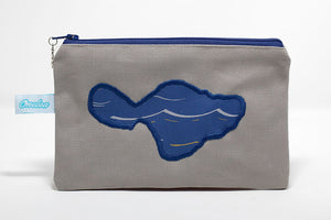 Tan canvas coin purse embroidered with shape of Maui in blue wave pattern fabric. Handmade in maui, hawaii