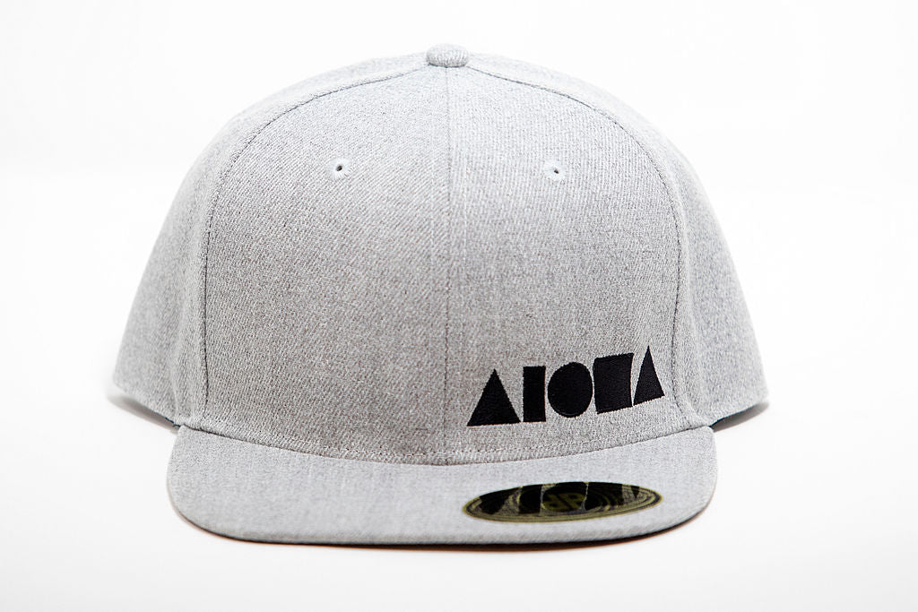 Grey adult flat brim snapback hat embroidered with black Aloha Shapes logo