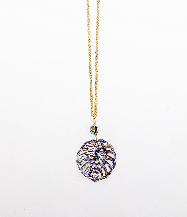 Carved abalone shell in shape of tropical Monstera leaf on 14 karat gold fill chain. Handmade in Maui, Hawaii