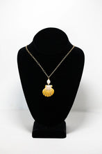 Hawaiian sunrise shell wire-wrapped pendant with freshwater pearl bead on 14 karat gold fill chain. Handmade in Maui, Hawaii
