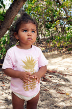 Young child standing amongst trees at beach wearing Repeat Pineapple Soley Aloha babies tee