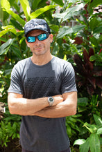 "Man wearing ""Undercover"" curved brim snapback with arms crossed and sunglasses on"