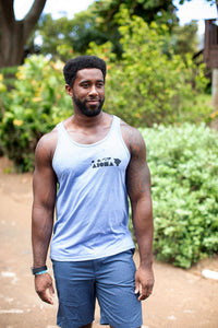 Muscular man smiling looking slightly away from camera wearing a blue Aloha Shapes ® unisex tanktop