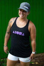 Woman smiling wearing Aloha Shapes® Islands racerback tank top and Flexfit style hat