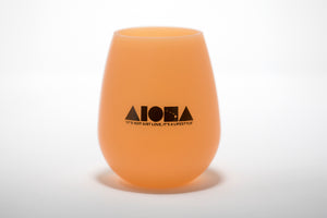 Silicone beach wine cup in orange printed with black ALOHA Shapes ® logo on front