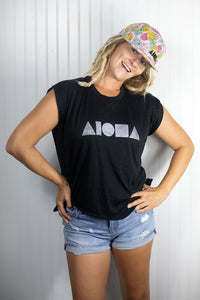 Blond dreadlocked girl wearing a Black and Silver Aloha Shapes ® flowy muscle tee