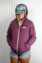 "Blond dreadlocked girl wearing Aloha Shapes ® logo ""Here Fishy Fishy"" snapback hat and zip-up hoodie"