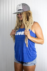 "Blond dreadlocked girl wearing ""Treasure of the Tropics"" snapback hat"