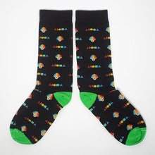Cotton dress socks printed with alternating rainbow shave ice cups and Aloha shapes logos.