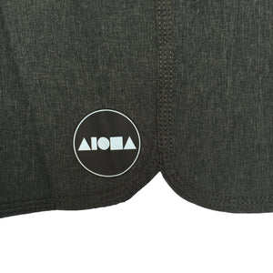 Detail image of circle Black/white Aloha Surf Shapes logo on bottom shorts leg