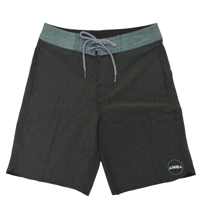 Youth Boys surf board shorts in grey with green waistband and pocket details. Black/white striped drawstring closure. Black/white circle Aloha Shapes® logo on bottom left shorts leg