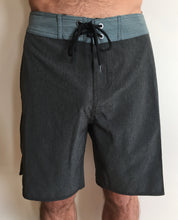 Close up image of man wearing Aloha Surf Shapes Board Shorts