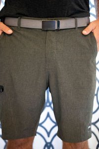 Detail image of mens Aloha Surf Shapes walk shorts worn with  a belt and hands in pockets
