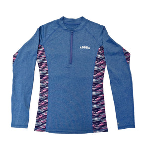 Womens surf rash guard top with 1/4 zip in front chest, Aloha Shapes® logo on front left chest area in silver. Blue with  pink/purple patterns under arms