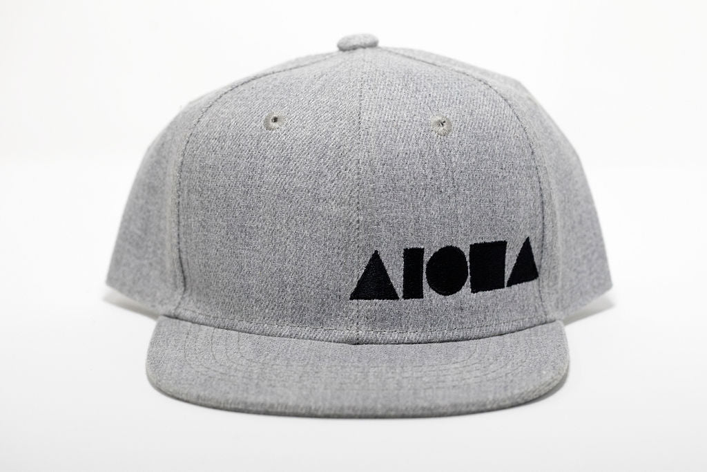 Grey canvas toddler flat brim snapback hat embroidered with black Aloha Shapes ® logo