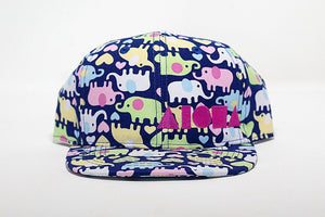 Elephant print fabric toddler flat brim snapback hat embroidered with pink Aloha Shapes ® logo