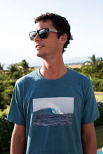 "Handsome young man wearing ""waves in wonderland"" t-shirt and sunglasses"