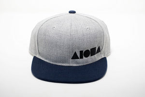 Navy blue and grey youth flat brim snapback hat embroidered with black Aloha Shapes ® logo