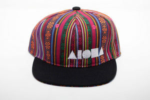 Youth flat brim snapback hat. Multi-colored Guatemalan fabric all over hat. Embroidered with white ALOHA Shapes ® logo