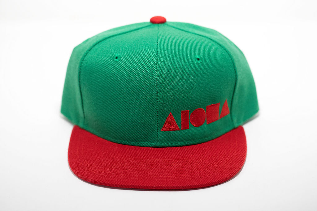 Red and green youth flat brim snapback hat embroidered with red Aloha Shapes ® logo