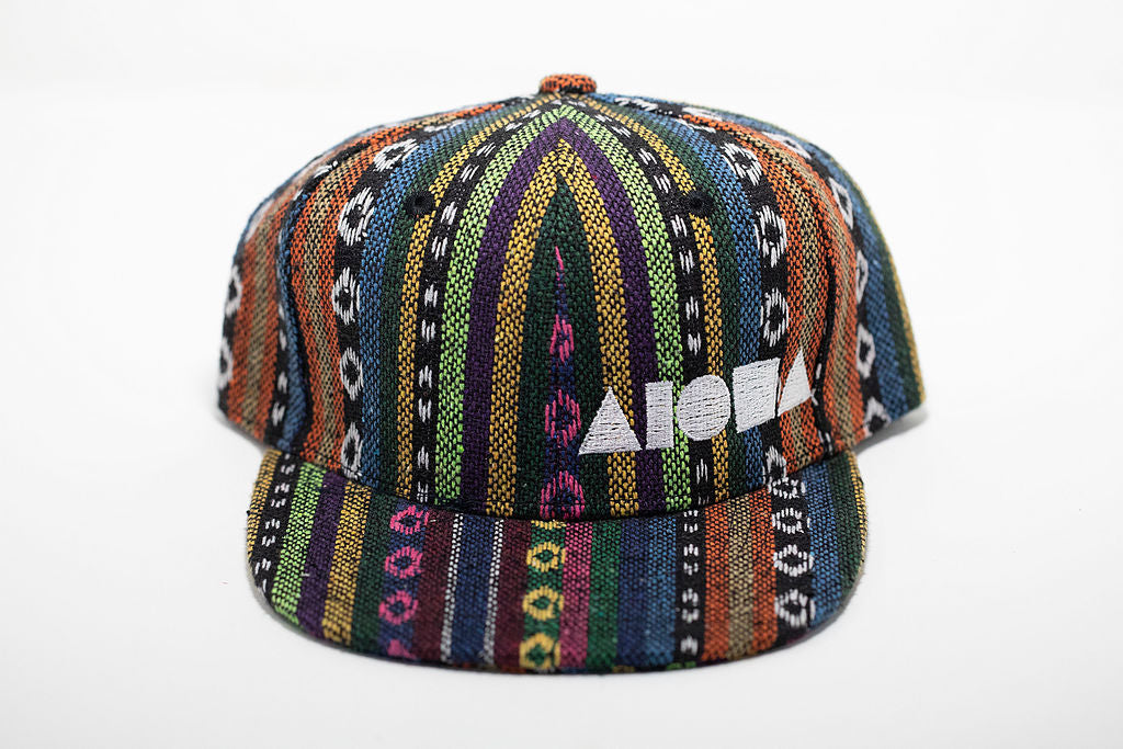 Multicolored striped Guatemalan fabric toddler flat brim snapback hat embroidered with white Aloha Shapes ® logo