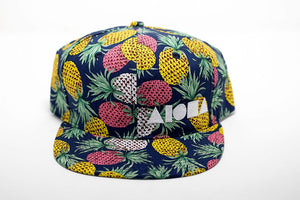 Adult Snapback hat with a tropical pineapple embroidered with white Aloha Shapes ® logo