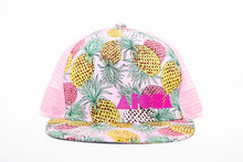 Adult flat brim snapback hat with tropical pink pineapple fabric on front and pink mesh back panels. Neon pink Aloha Shapes logo embroidered on front