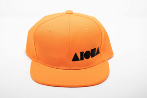 Orange youth flat brim snapback hat embroidered with black Aloha Shapes ® logo