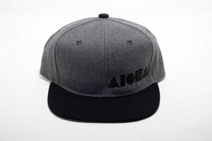 Youth flat brim snapback hat with black and grey canvas embroidered with black Aloha Shapes ® logo